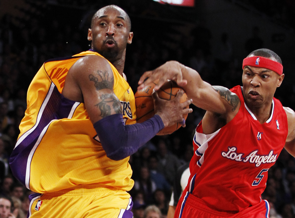 An NBA rivalry in LA - Los Angeles Clippers' Caron Butler, right, and Los Angeles Lakers' Kobe Bryant.