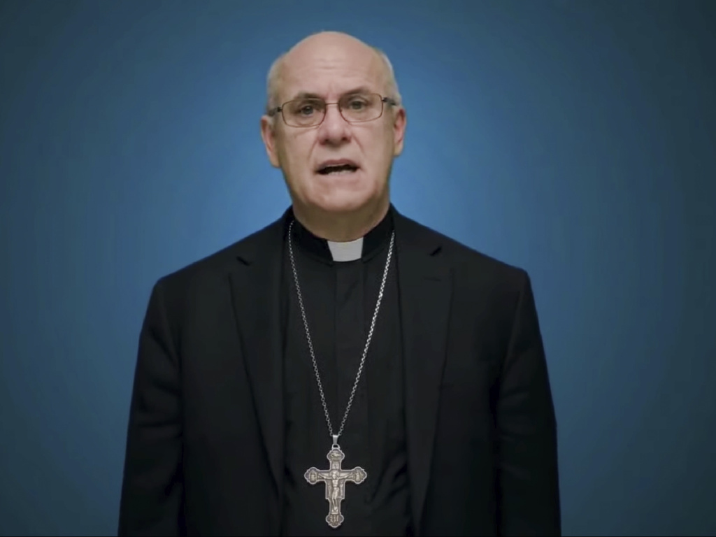 In this photo taken from video, Bishop Kevin Rhoades of Fort Wayne-South Bend, Ind., head of the doctrine committee for the U.S Conference of Catholic Bishops, addresses the body's virtual assembly regarding a formal statement on the meaning of the Eucharist in the life of the church on Thursday.