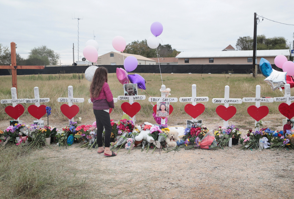 Visitors pay their respects at a memorial where 26 crosses were placed to honor the 26 people killed at the First Baptist Church of Sutherland Springs on November 5, 2017 in Sutherland Springs, Texas.