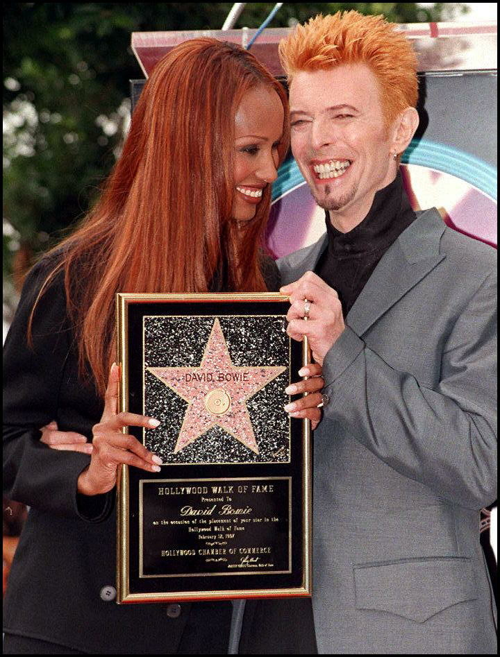 File: Rock music superstar David Bowie (R) and his wife, supermodel Iman smile as they pose for photos after Bowie received a star on the world-famous Walk of Fame Feb. 12 in Hollywood.