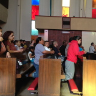 Latino parishioners at Our Lady of the Holy Rosary Church in Sun Valley listen to a mass centered around the topic of comprehensive immigration reform.