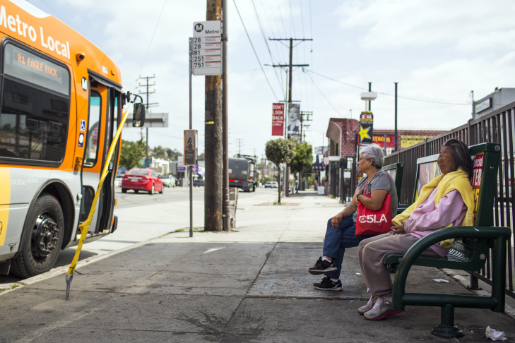 A bus shelter on North Figueroa Street at Avenue 26 in Lincoln Heights doesn't have overhead shelter. Bus riders say it is difficult to find shade, especially in the afternoon.