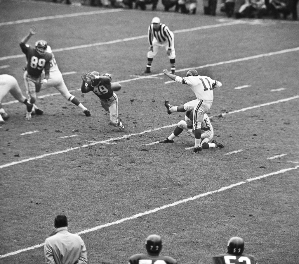A field goal attempt by Los Angeles Rams' Danny Villanueva (11) gets blocked in the first period of an NFL game in New York's Yankee Stadium, Oct. 22, 1961. Villanueva went on to a career in broadcasting and became the president of KMEX and part-owner in a Spanish-language chain that would later become Univision. Villanueva died Thursday, June 18, 2015, at the age of 77.