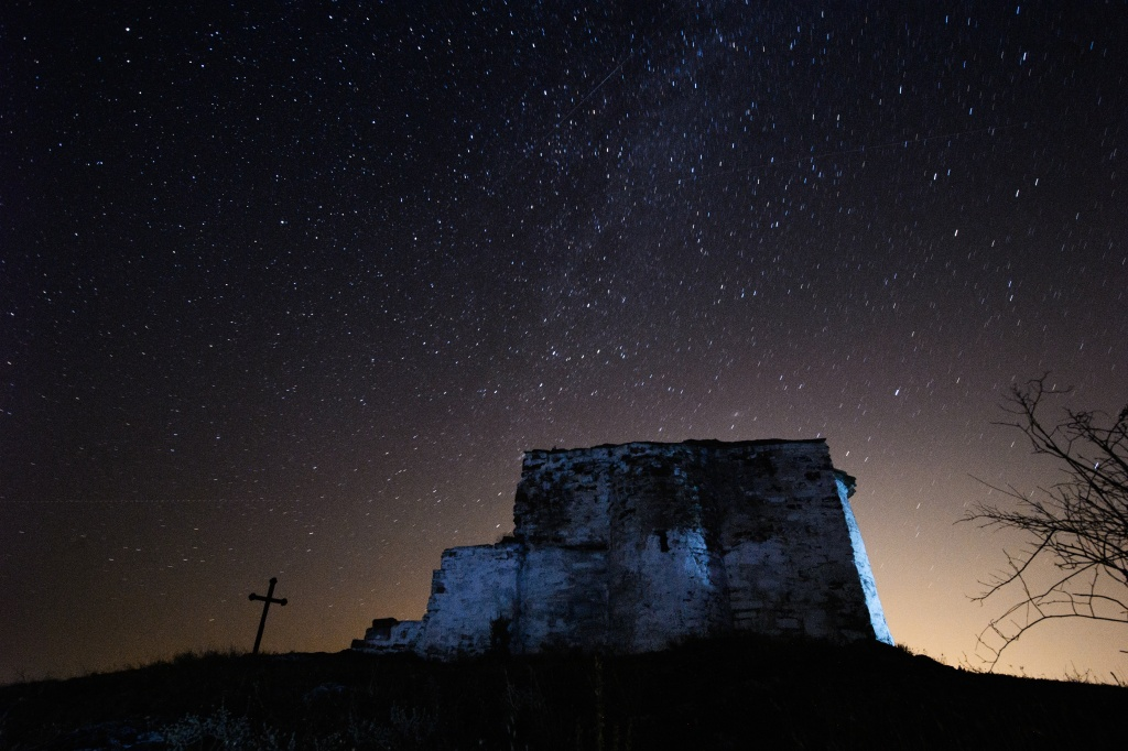 File: A long exposure image showing a Perseids meteor (L) streaking across the night sky over St. Ioan medieval church near the village of Potsurnentsi, late on August 12, 2013. This year the Perseids coincides with the new moon which means a greater chance at seeing shooting stars.