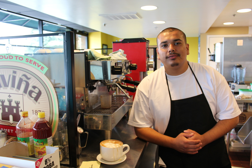 Working at 3 Worlds Cafe is 20-year-old Oscar Guizar's first job. He said he's grateful for the opportunity.