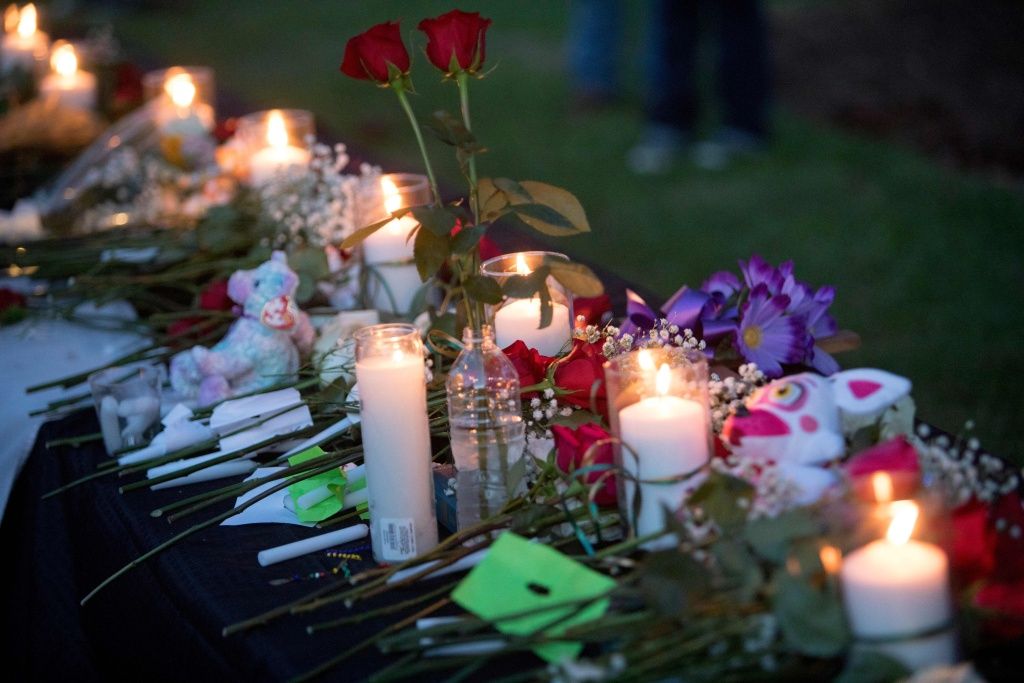Candles, flowers and stuffed animals line a table during a vigil in Santa Fe, Texas for the victims of the mass shooting on May 18, 2018. Ten people, mostly students, were killed when a teenage classmate armed with a shotgun and a revolver opened fire in a Texas high school May 18, 2018, the latest deadly school shooting to hit the United States.