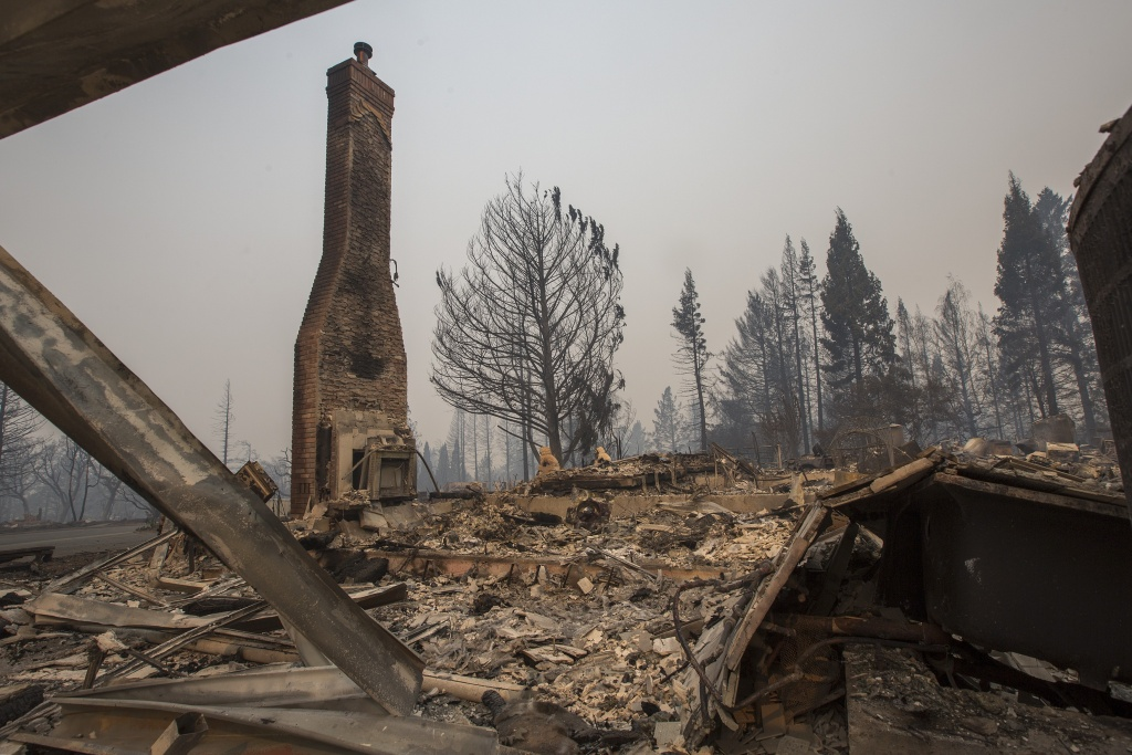 SANTA ROSA, CA - OCTOBER 10: A neighborhood is destroyed by fire in the area of Foxtail Court, on October 10, 2017 in Santa Rosa, California. In one of the worst wildfires in state history, at least 1,500 homes have burned and 11 people have died as more than 14 wildfires continue to spread in eight Northern California counties.   (Photo by David McNew/Getty Images)
