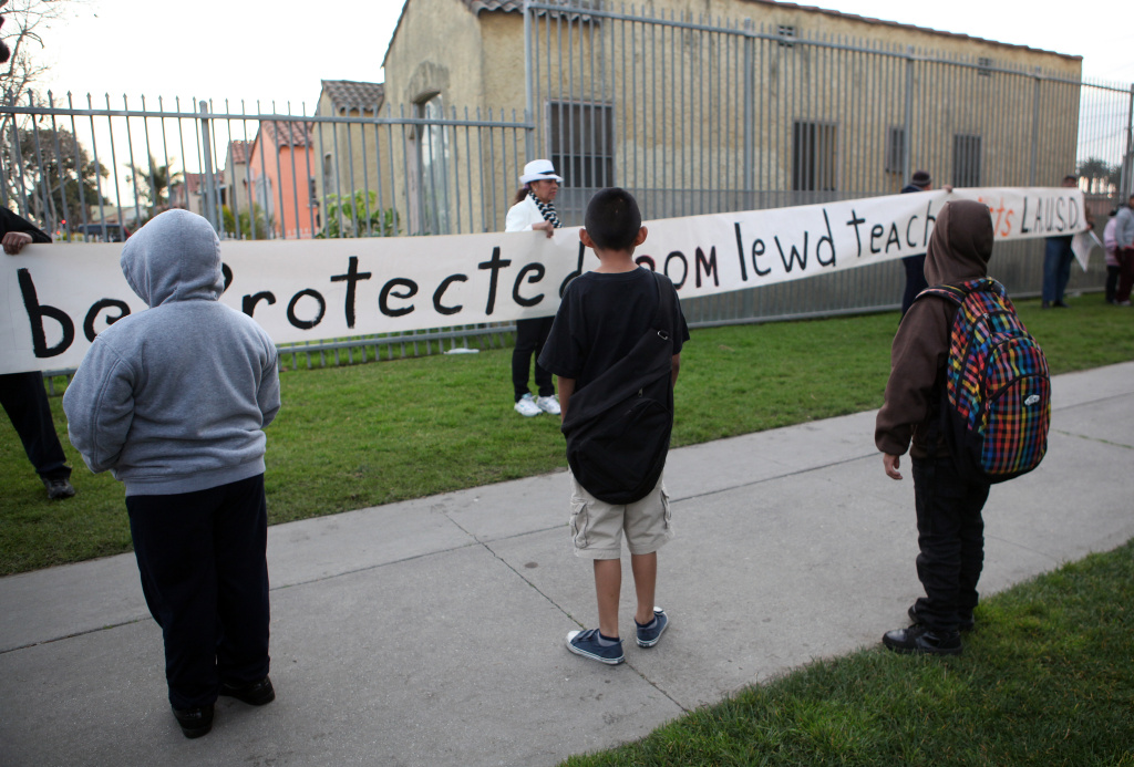 Parents and children protest outside Miramonte Elementary School in Los Angeles, California, February 6, 2012.