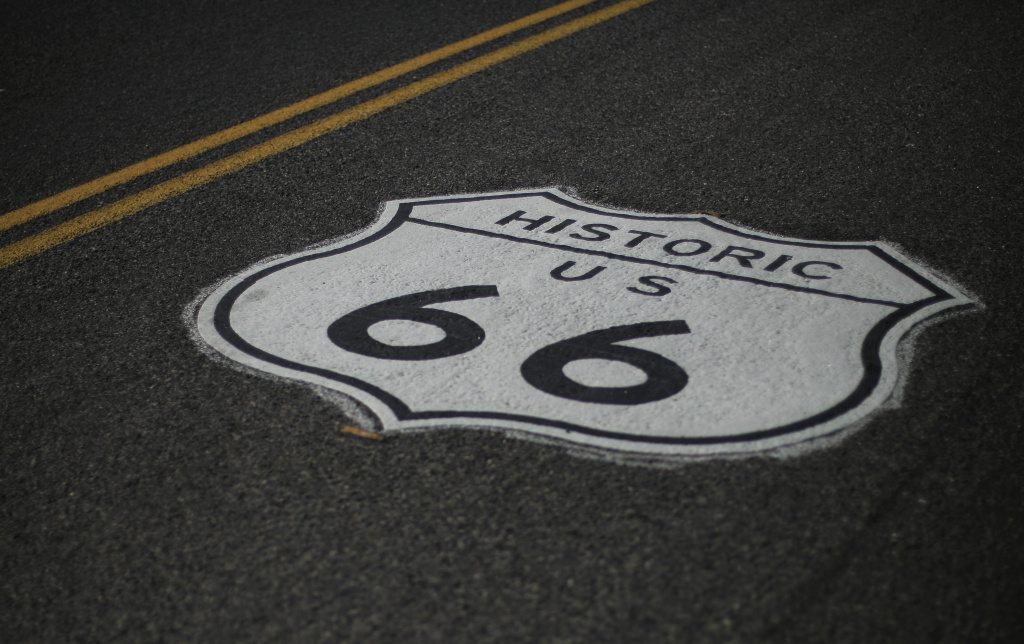 A road marking of the historic Route 66 sign is seen painted on the street of the town of Kingman, on October 31, 2010. AFP PHOTO / ALEXANDER KLEIN (Photo credit should read ALEXANDER KLEIN/AFP/Getty Images)