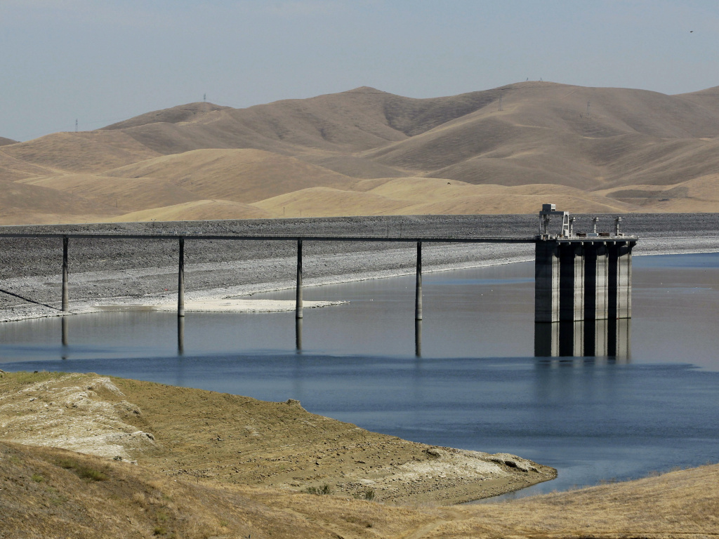 Low water levels, like at this reservoir near Gustine, Calif., bring birds and mosquitoes together and help transmit West Nile virus to humans.