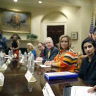 White House aide Omarosa Manigault speaks to a health care panel in June. On Friday she was part of a panel at a black journalists conference that ended with the audience protesting her participation.