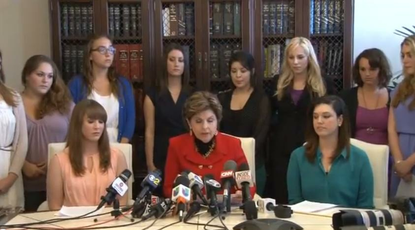 Attorney Gloria Allred and Occidental College sexual abuse victims announce a federal complaint against the small, liberal arts college on April 18, 2013.