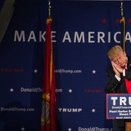 Republican presidential candidate Donald Trump references fellow candidate Jeb Bush at a Pearl Harbor Day Rally at the U.S.S. Yorktown December 7, 2015, in Mt. Pleasant, South Carolina.