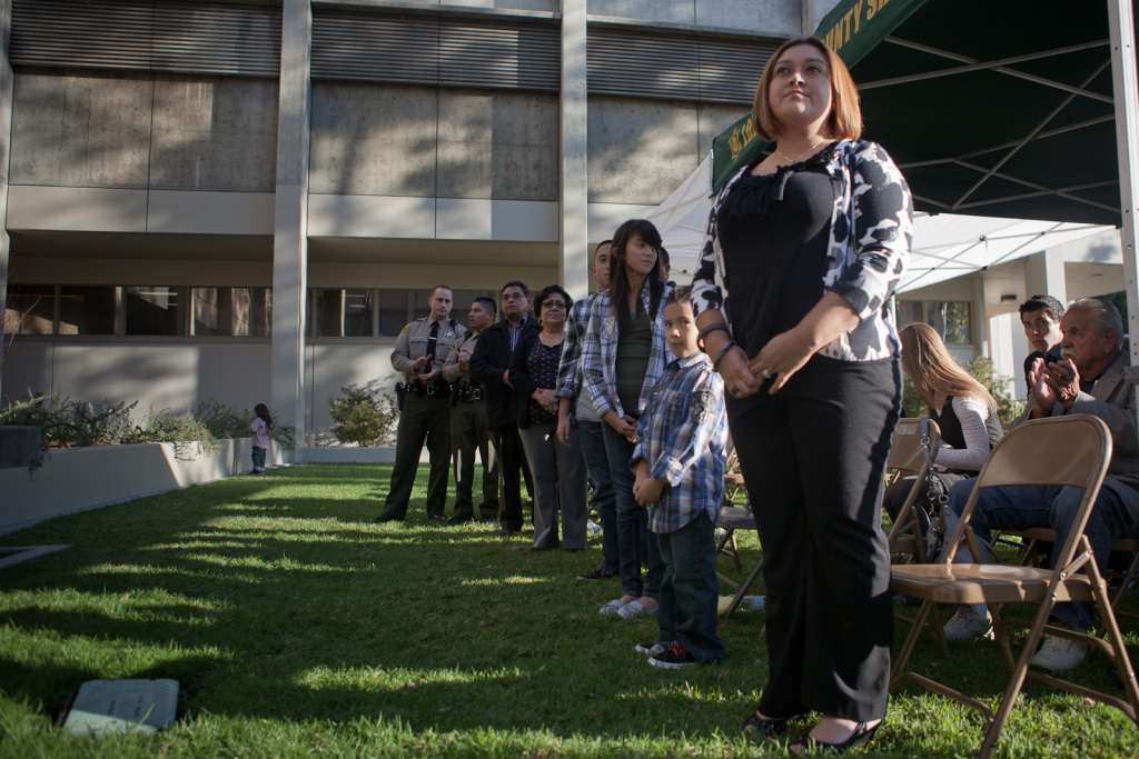 The widow of slain county sheriff's officer Juan Escalante looks on at a memorial ceremony for her husband who lost his life when he was shot by a gang member outside his home in 2008.