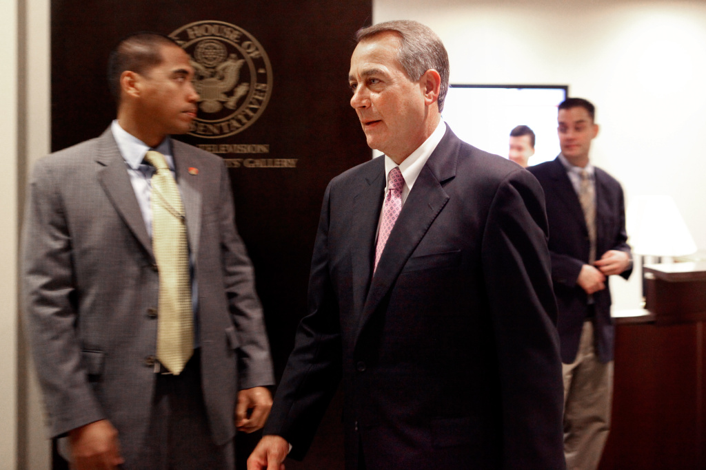 Speaker of the House John Boehner (R-OH) heads back to his office after a news conference with fellow GOP House members who want to negotiate new payroll tax cut legislation at the U.S. Capitol December 22, 2011 in Washington, DC.