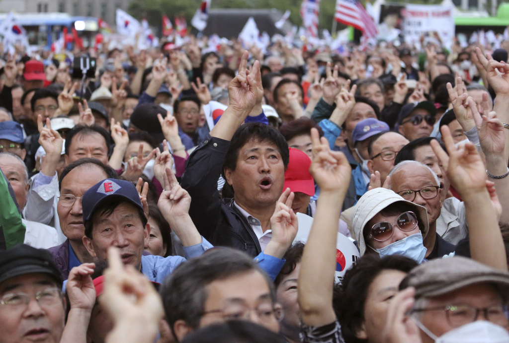 Supporters of South Korean presidential candidate Hong Joon-pyo of the Liberty Korea Party shout his name during an election campaign in Seoul, South Korea, Monday, May 8, 2017. Two months after booting their sitting president over corruption allegations, South Koreans will select a new leader Tuesday after weeks of heated debate. (AP Photo/Ahn Young-joon)