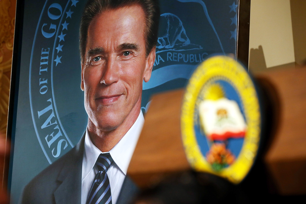 The official gubernatorial portrait of former California Gov. Arnold Schwarzenegger is displayed in the Rotunda of the State Capitol following an unveiling ceremony September 8, 2014 in Sacramento, California. Former California Gov. Arnold Schwarzenegger was joined by current Gov. Jerry Brown to unveil his official gubernatorial portrait at the State Capitol.
