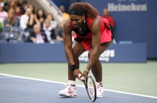 Serena Williams of the United States reacts while playing against Samantha Stosur of Australia during the Women's Singles Final on Day Fourteen of the 2011 US Open.