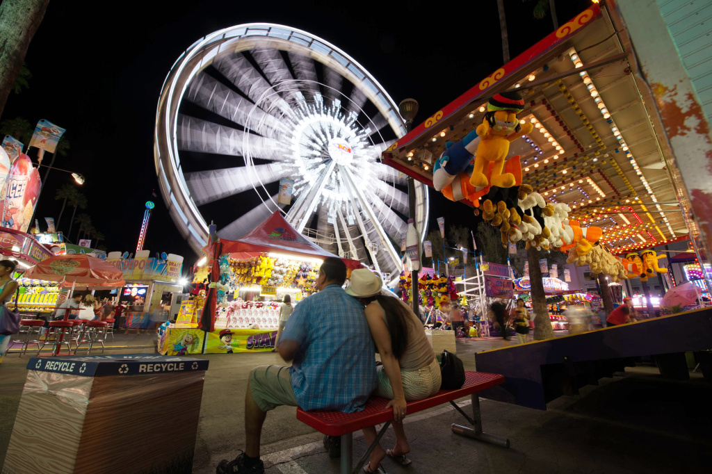 File: Visitors attend the Los Angeles County Fair 2013 in Pomona, California on Sept. 4, 2013.