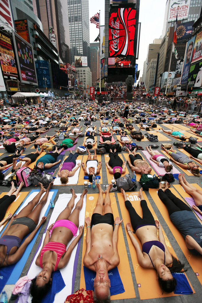 Potential future Olympians perform yoga in Times Square.