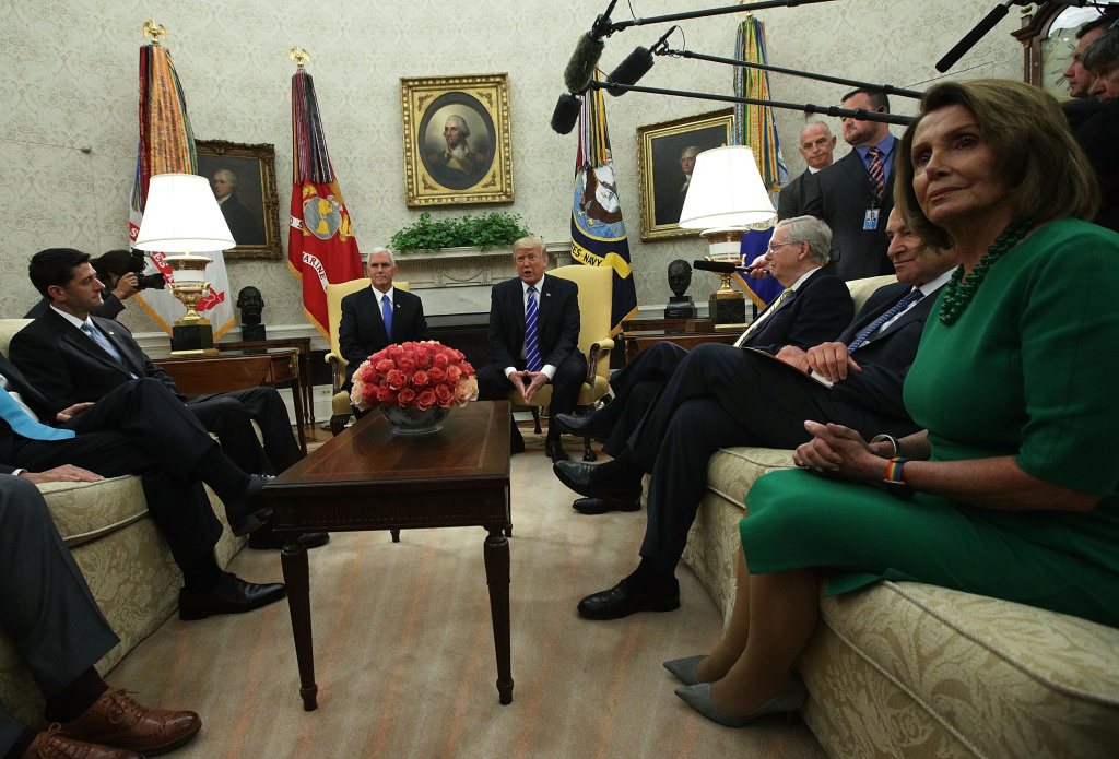 U.S. President Donald Trump (3rd L) and Vice President Mike Pence (2nd L) meet with (L-R) Speaker of the House Paul Ryan (R-WI), Senate Majority Leader Mitch McConnell (R-KY), Senate Minority Leader Chuck Schumer (D-NY) and House Minority Leader Nancy Pelosi (D-CA) in the Oval Office of the White House September 6, 2017 in Washington, DC. President Trump met with Congressional leaders to discuss bi-partisan issues.