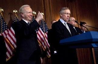 Senator Joe Lieberman (I-CT), left, gives a thumbs us while arriving for a procedural vote to repeal Don't Ask, Don't Tell.