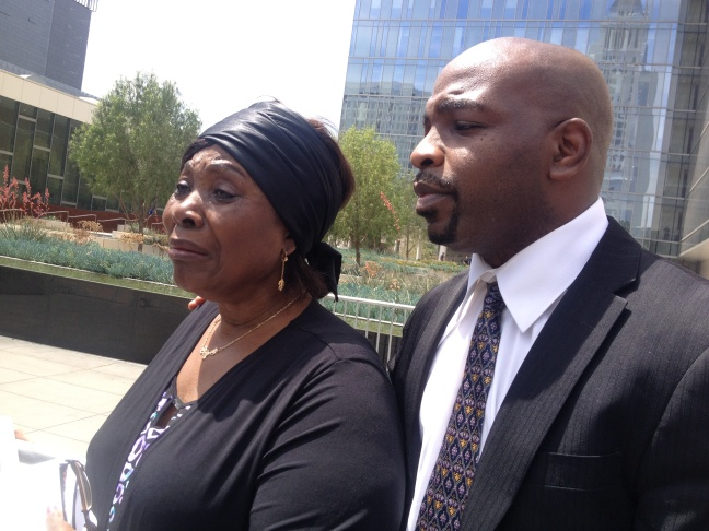 Charly Keunang's sister Line Marquise Foming, mother Heleine Tchayou and attorney Emmanuel Nsahlai outside LAPD Headquarters April 30, 2015.