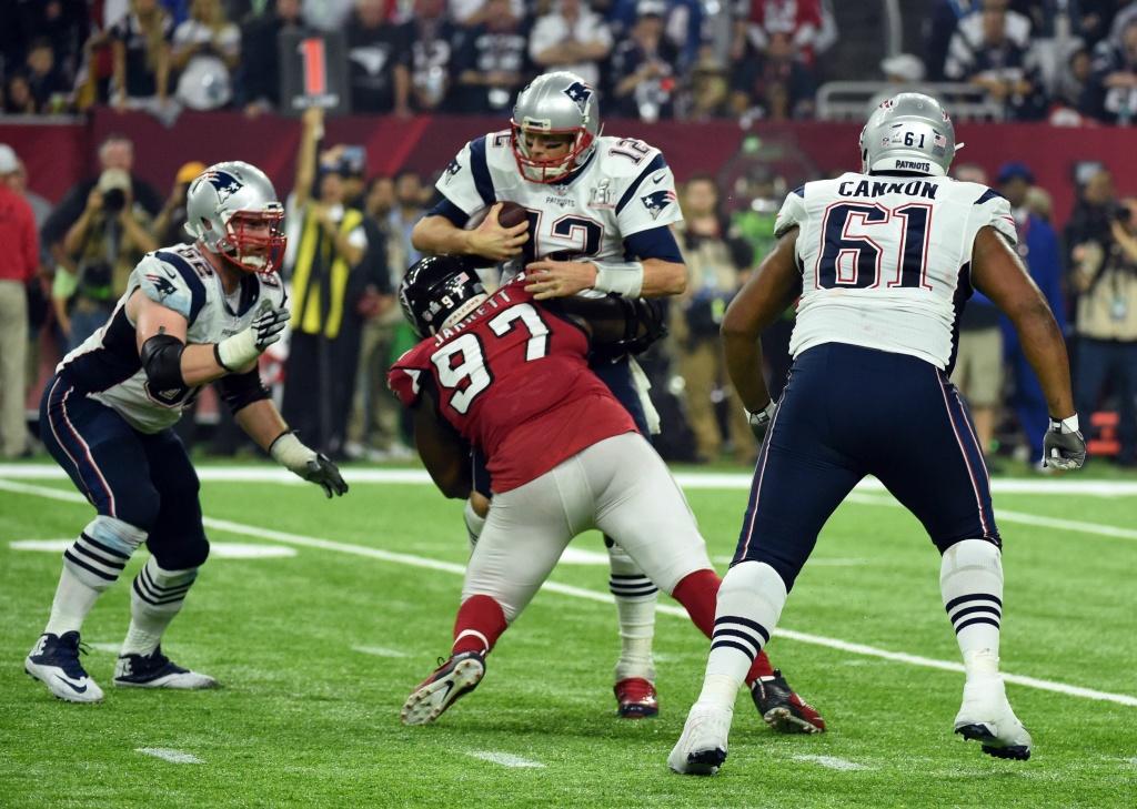 Tom Brady of the New England Patriots is sacked by Grady Jarrett of the Atlanta Falcons.