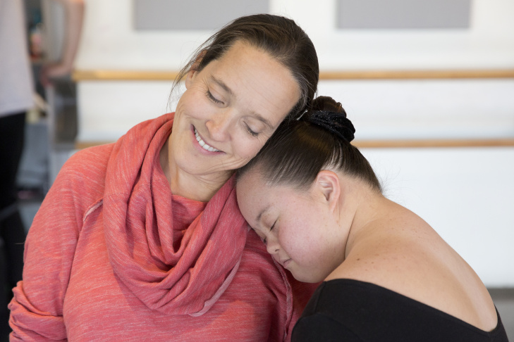 Bonnie Schlachte, director of Ballet for All Kids, works with Liam Kay, 9, during class at the Los Angeles Ballet Academy.