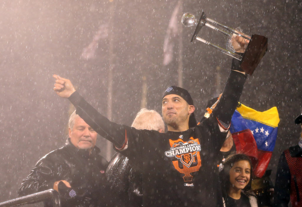 Marco Scutaro #19 of the San Francisco Giants holds up the MVP trophy after the Giants defeat the St. Louis Cardinals 9-0 in Game Seven of the National League Championship Series at AT&T Park on October 22, 2012 in San Francisco, California.