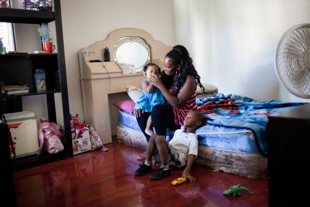 Harvesha Knight plays with her children Darniyah Davis and Darryl Jr. Davis. Harvesha is pursuing her nursing degree, but has had to put off school because her local preschool hasn't opened its doors this school year.