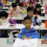 Children participate in a drawing contest on May 13 celebrating international children's day in Qingdao, China.