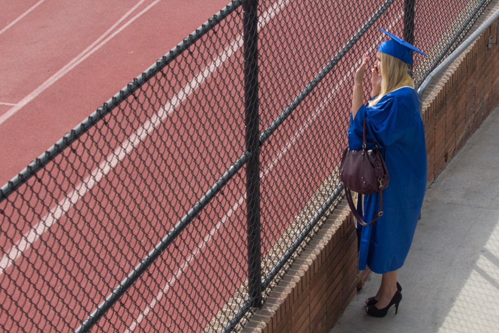 A student waves to her friend at the Santa Monica College graduation on June 11th, 2013.