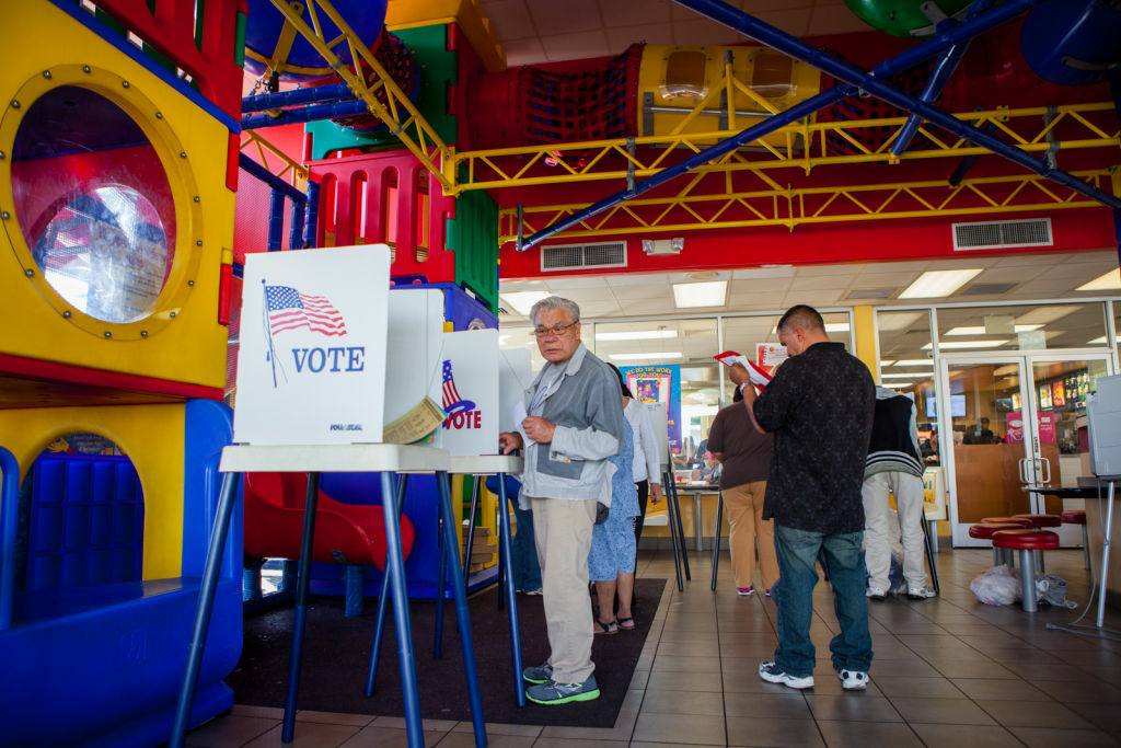 Voters fill out ballots at the McDonald's Play Room in Hollywood on November 6th, 2012. Photographing polling places is okay - but California has laws against photographing marked ballots.