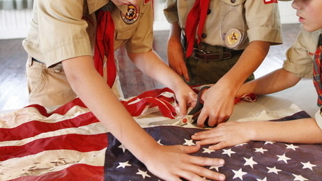 "Scouts participate in a flag retirement ceremony. People involved with the Boy Scouting movement face the court-ordered release of the organization's ""perversion files"" with mixed emotions."