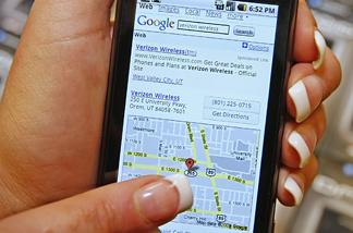 A manager demonstrates Motorola's new Droid smart phone sold through Verizon at the Verizon store November 5, 2009 in Orem, Utah.