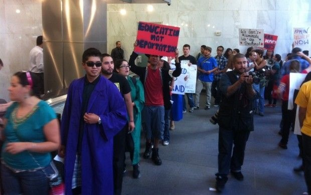 Undocumented students and their supporters protest in federal office building in Los Angeles, October 12, 2011