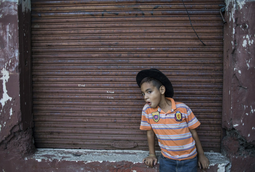 A boy stands outside his house in Managua, Nicaragua on April 14, 2014.