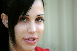 'Octomom' Nadya Suleman poses for photographers in front of her home in La Habra, California on May 19, 2010.