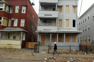 An abandoned property is boarded up on March 12, 2010 in Bridgeport, Connecticut.