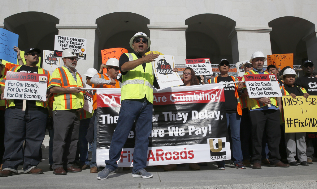 Supporters of a plan for a $5 billion-a-year tax and fee road repair measure rallied at the Capitol, Wednesday, April 5, 2017, in Sacramento, Calif. The bill, SB1, supported by Calif., Gov. Jerry Brown and Democratic Legislative leaders, is expected to be voted on by the California Legislature, on Thursday. (AP Photo/Rich Pedroncelli)