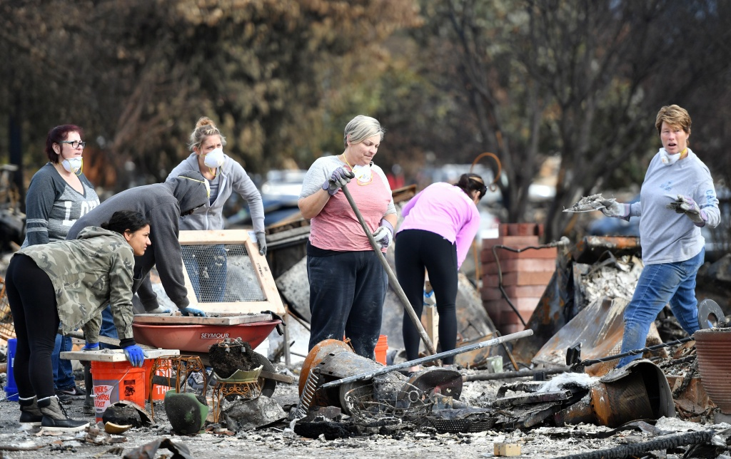 Residents search for an engagement ring at a burned residence in Santa Rosa, California on October 20, 2017. Residents are being allowed to return to their burned homes on October 20 to grieve and search through remains. Around 5,700 homes and businesses have been destroyed by the fires, the deadliest in California's history. / AFP PHOTO / JOSH EDELSON        (Photo credit should read JOSH EDELSON/AFP/Getty Images)