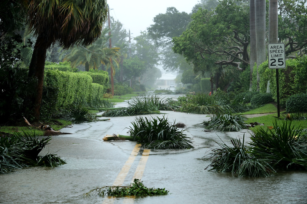 Broken tree branches block roads in the Coral Beach neighborhood as Hurricane Irma hits the southern part of the state September 10, 2017 in Fort Lauderdale, Florida. The powerful hurricane made landfall in the United States in the Florida Keys at 9:10 a.m. after raking across the north coast of Cuba.