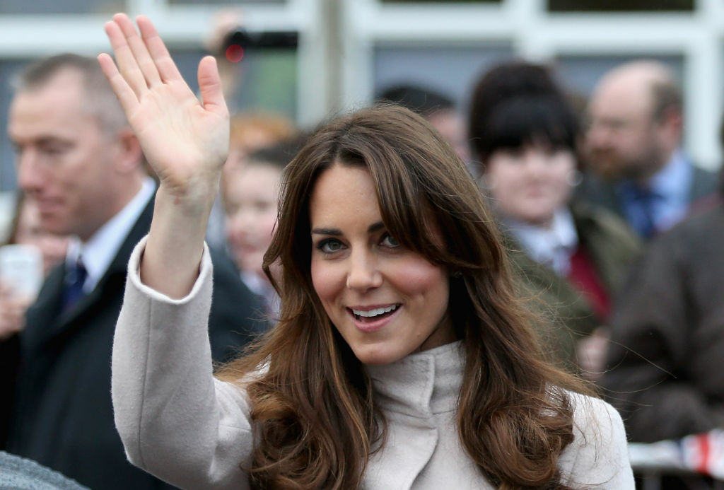 Catherine, Duchess of Cambridge waves as she leaves  Manor School as she pays an official visit to Cambridge with Prince William, Duke of Cambridge on November 28, 2012 in Cambridge, Cambridgeshire.