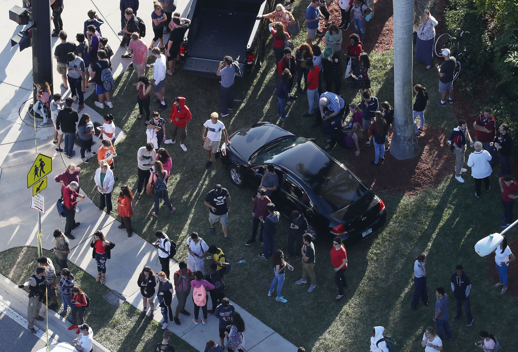 People wait for loved ones as they are brought out of the Marjory Stoneman Douglas High School after a shooting at the school on Feb. 14, 2018 in Parkland, Florida..