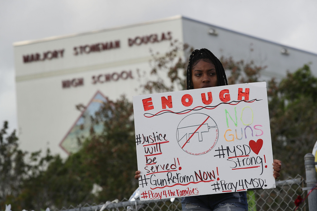Tyra Heman, a senior at Marjory Stoneman Douglas High School in Parkland, Florida, protests against the proliferation of guns after a gunman killed 17 people at her school on Valentine's Day.