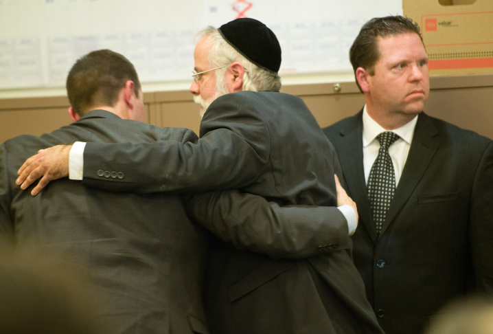 Former Fullerton police Officer Jay Cicinelli was  acquitted of involuntary manslaughter and assault under color of authority for his role in the July 5, 2011, beating of transient Kelly Thomas. He put his head in his hands and kept his head down immediately after hearing he would walk free.  POOL PHOTO, MINDY SCHAUER, ORANGE COUNTY REGISTER