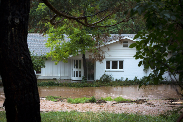 A house on Linden Drive appears to be at risk of flooding after three days of heavy rainfall September 12, 2013 in Boulder, Colorado. An estimated 6-10 inches of rain fell in 12-18 hours and more is expected throughout the day. Flash flood sirens warned people to stay away from Boulder Creek and seek higher ground.