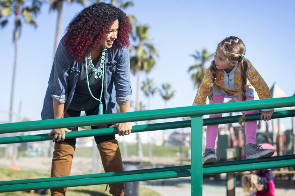Delia Douglas-Haight plays with her 5-year-old mixed-race daughter, Soleil Haight, at the Venice Beach Boardwalk Playground on Tuesday afternoon, Jan. 17, 2017. Douglas-Haight says she's always had to deal with questions about her heritage, down to well-meaning strangers asking if she was Soleil's nanny.