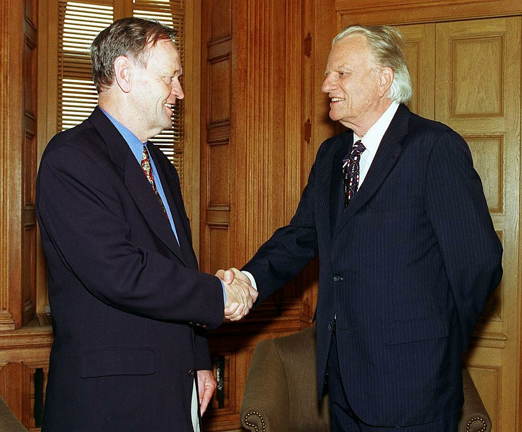 Canadian Prime Minister Jean Chretien shakes hands with Reverend Billy Graham on June 23 during a meeting on Parliament Hill in Ottawa, Canada. Reverend Graham is in Ottawa for a four day mission.